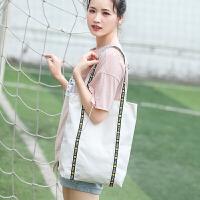 春夏新款帆布单肩包女简约条纹百搭森系ins超火布袋包学生韩国版