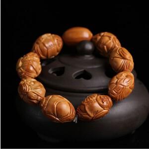 天然橄榄精雕地主财神佛珠手串橄榄胡苏工南工名家橄榄核手链拍卖