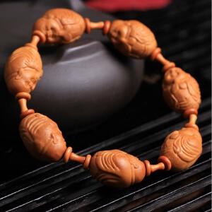 天然橄榄核雕刻一心向佛佛珠手串一手货源天然油亮
